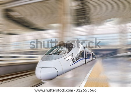 High speed train at the railways station of  Beijing. Speed train is  comfortable and speed and most convenience in China Republic. - stock photo
