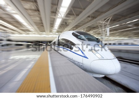 High speed train departure from station,china - stock photo