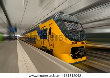 High-speed train in Netherlands with motion blur - stock photo