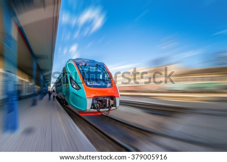High-speed train with motion blur. Train at the railway station.