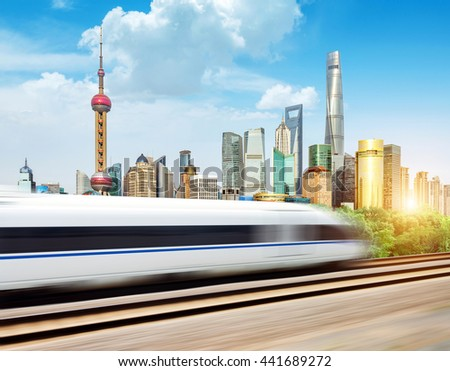 High-speed trains in the Shanghai Lujiazui City background - stock photo