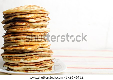 High stack of pancakes . Breakfast for the whole family . With copy space. Shallow DOF - stock photo