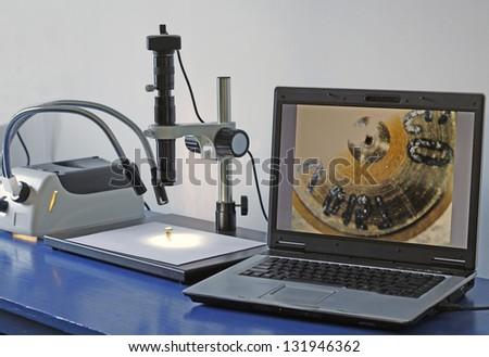 High-tech car service laboratory with digital microscope. - stock photo