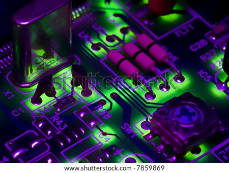 High-tech digital electronics, strong colours and backlit - stock photo