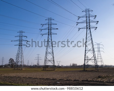 high-tension pylons - stock photo