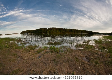 High tide inundates Pleasant Bay, a beautiful bay on Cape Cod that is great for sailing, paddling, and fishing. - stock photo