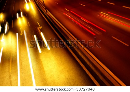 High traffic road with automobile light trails in a rush-hour - stock photo