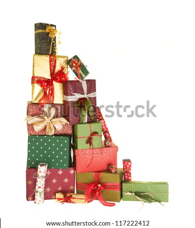 High up stack of christmas presents with beautiful decorative bows and feathers - stock photo