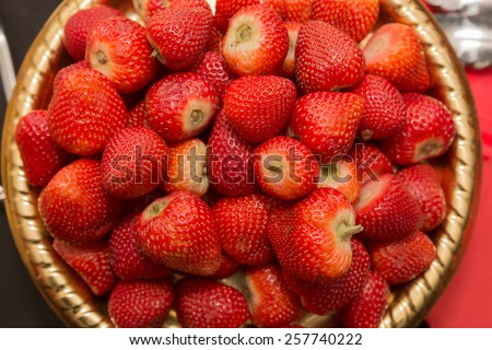 High view of lots of fresh juicy strawberries in a tub - stock photo