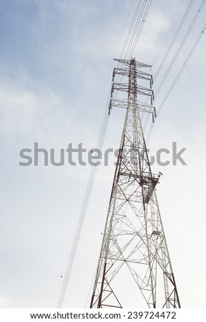 High voltage AC transmission towers/A transmission tower  - stock photo