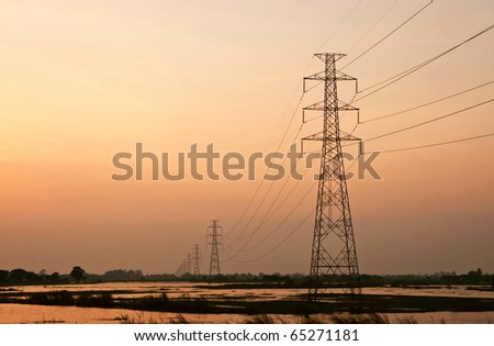 high voltage cable on sunset - stock photo