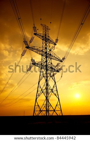 High voltage electric line in sunset - stock photo