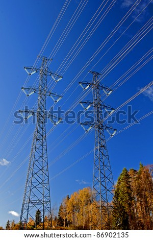 High-voltage electric main against the dark blue sky in the city of Imatra, Finland - stock photo