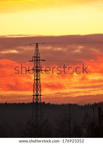 High voltage electric power line during sunset.