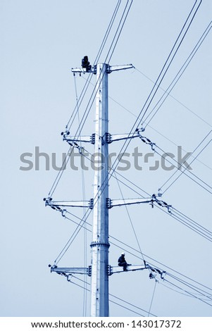 high voltage electric power steel tube tower under the blue sky