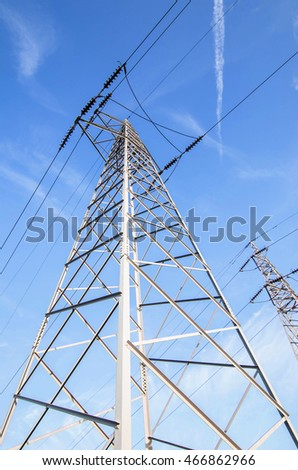 High Voltage Electric Towers on a blue sky
