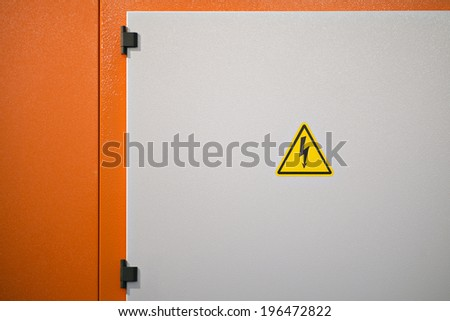 High voltage electrical hazard sign on a machine - stock photo