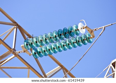 High-voltage electrical insulator electric line against the dark blue sky - stock photo