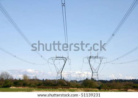 High voltage electricity pylon power line. - stock photo