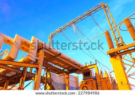 High-voltage industrial electric equipment with night-time lighting - stock photo