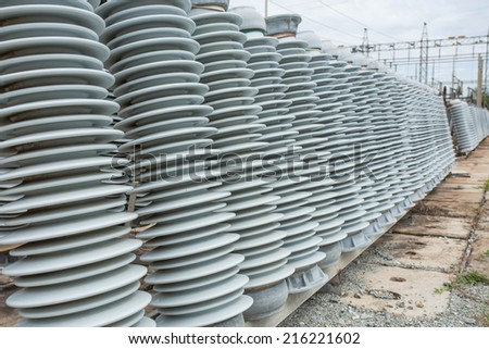 High voltage insulators at new substation - stock photo