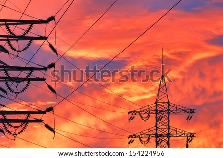 High Voltage Line over sunset background. - stock photo