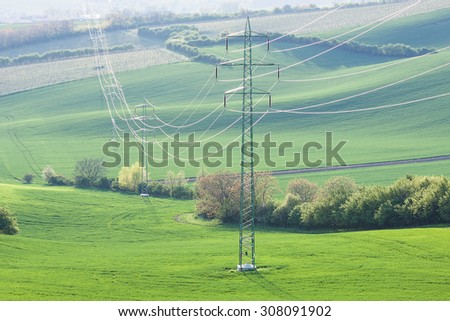 High voltage lines and power pylons at the rural landscape - stock photo
