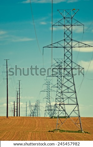 High voltage lines crossing newly planted fields in north central Colorado, USA. retro instagram look - stock photo