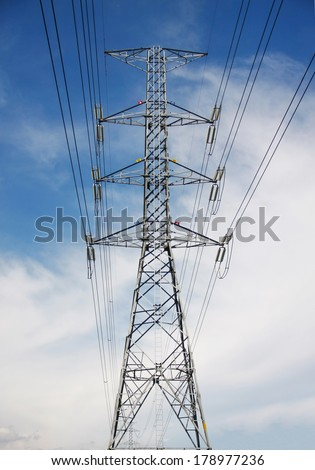 high voltage pole construction with blue sky and cloud