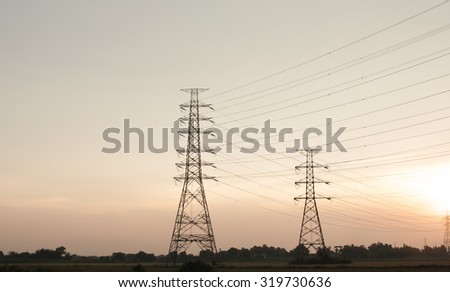 High voltage pole on blue sun .