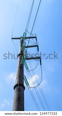 High-voltage pole with blue sky - stock photo
