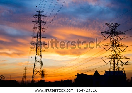 High voltage poles on sunset