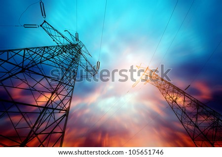 high voltage post at sunset - stock photo