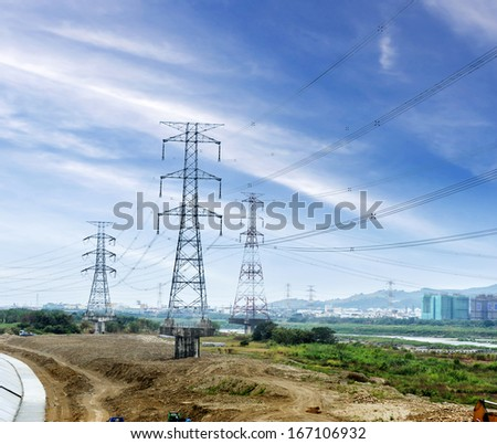 high voltage post.High-voltage tower in the countryside