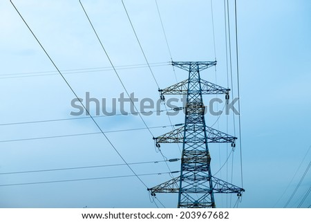 high voltage post.High-voltage tower sky background - stock photo