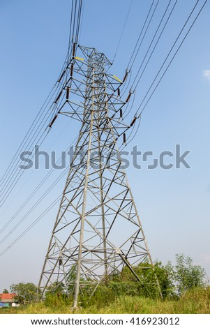 high voltage post.High-voltage tower with blue sky background.