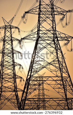 High voltage post. High-voltage tower with sunset and sky background