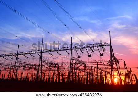 High voltage power grid, in the sunset  - stock photo