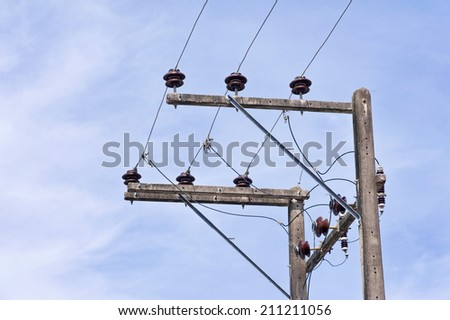 High voltage power line in a rural community  - stock photo