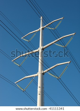 High voltage power line towers shot from below