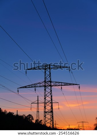High voltage power lines on sunset - stock photo