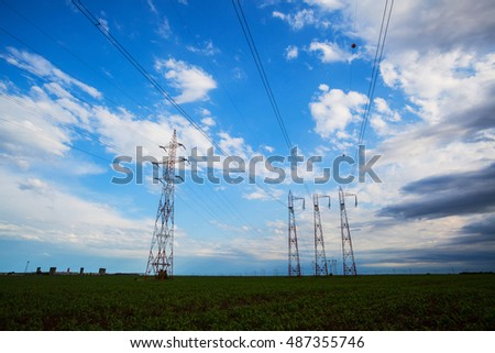 High voltage power lines over blue sky