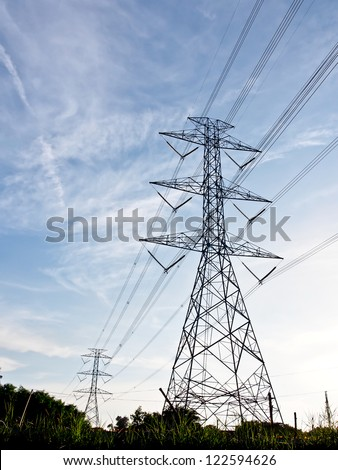 high voltage power lines with blue sky - stock photo