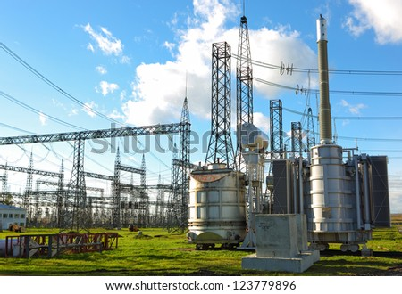 High voltage power lines with blue sky and clouds - stock photo