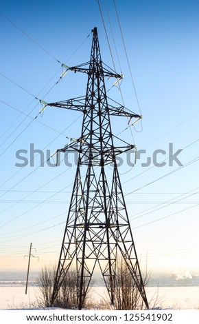 High voltage power lines with winter blue sky and clouds