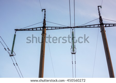 High voltage power pylons against blue sky. High voltage power towers against blue sky.