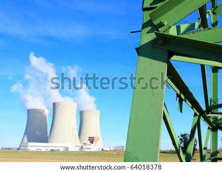 High voltage power tower close up and nuclear power plant Temelin in Czech Republic Europe Close up with shallow DOF.