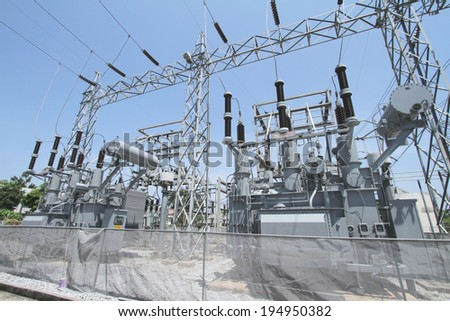 High voltage power transformer in substation - stock photo