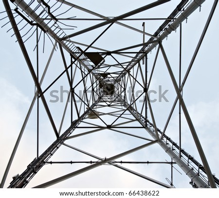 High voltage pylon for mobile phones reception. View from bottom. - stock photo