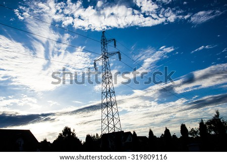 High voltage pylon with blue sky in the background.